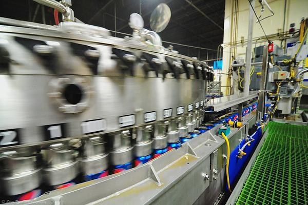 Filler machines fill 1,000 cans per minute.