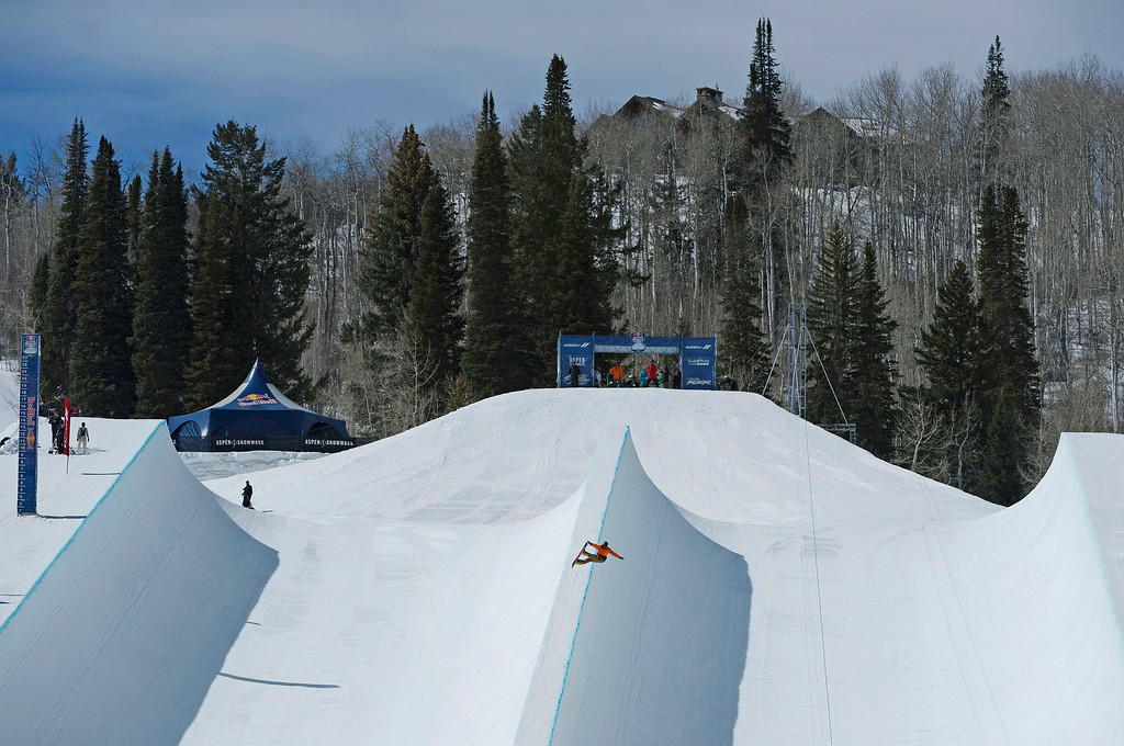 . A  professional snowboarder launches off the 4\' spine of the Red Bull double pipe during practice at Buttermilk Mountain Friday morning, March 21, 2014.  (Photo By Andy Cross / The Denver Post)