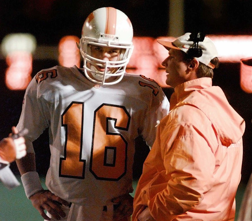 . University of Tennessee assistant head coach David Cutcliffe talks with quarterback Peyton Manning during their 14-7 win over Vanderbilt on Nov. 30, 1996, in Nashville.  Manning insists he hasn\'t decided whether to join the NFL or return for another season as Tennessee\'s quarterback.  ``I was hoping it was going to be an easy decision,\'\' he told The Knoxville News-Sentinel. ``I was hoping it would be a no-brainer.\'\'(AP Photo/Mark Humphrey)