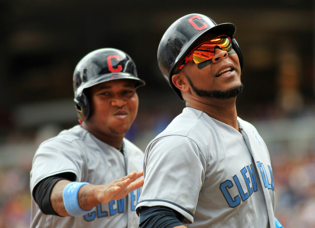 . Cleveland Indians Edwin Encarnacion (10) is congratulated by Cleveland Indians Jose Ramirez after a two-run home run against the Minnesota Twins in the fourth inning during a baseball game on Sunday, June 18, 2017 in Minneapolis. (AP Photo/Andy Clayton-King)