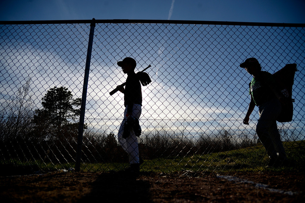. Aurora, CO - APRIL 08: Overland Trailblazers freshman Chris Mena (left) and Ethen Saenz walk near the playing field as the varsity team hosted the Cherry Creek Bruins. Overland hosted Cherry Creek on Tuesday, April 8, 2014. (Photo by AAron Ontiveroz/The Denver Post)