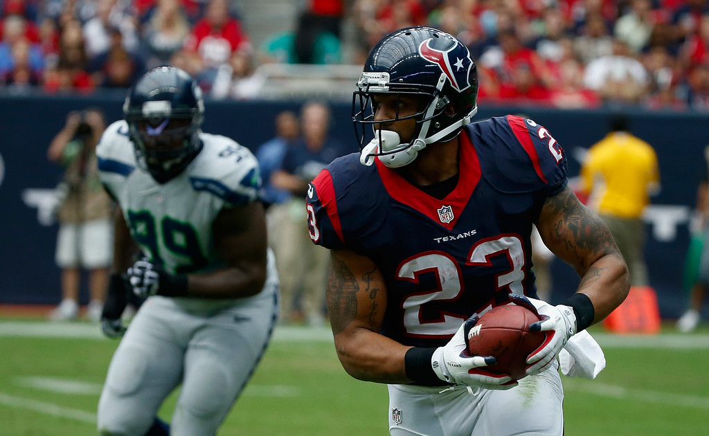 . HOUSTON, TX - SEPTEMBER 29:  Arian Foster #23 of the Houston Texans runs upfield in the first half against the Seattle Seahawks at Reliant Stadium on September 29, 2013 in Houston, Texas.  (Photo by Scott Halleran/Getty Images)