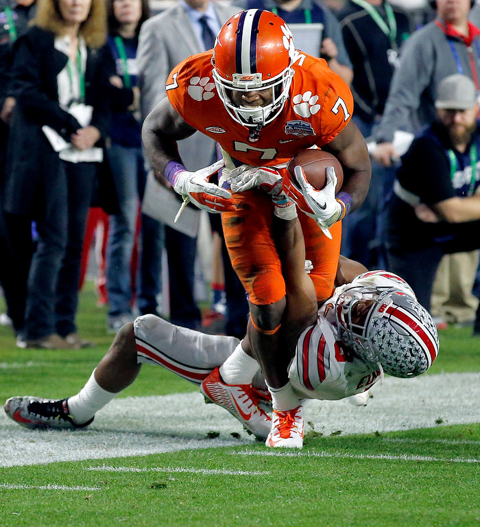 . Clemson wide receiver Mike Williams (7) is stopped by Ohio State cornerback Gareon Conley (8) during the second half of the Fiesta Bowl NCAA college football playoff semifinal, Saturday, Dec. 31, 2016, in Glendale, Ariz. (AP Photo/Ross D. Franklin)