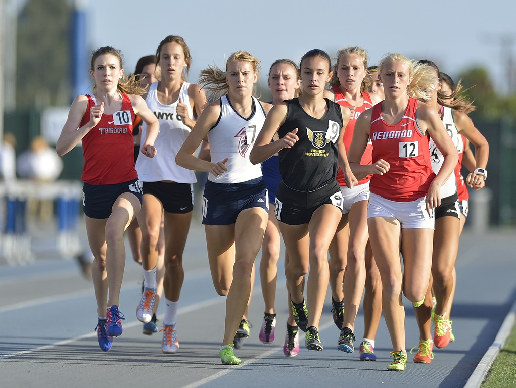 . NORWALK, CALIF. USA -- Redondo Union\'s Kayla Ferron, far right, competes in the 1600 meter race during the CIF-SS Masters Track and Field Meet in Norwalk, Calif., on Friday, May 24, 2013. Photo by Jeff Gritchen / Los Angeles Newspaper Group