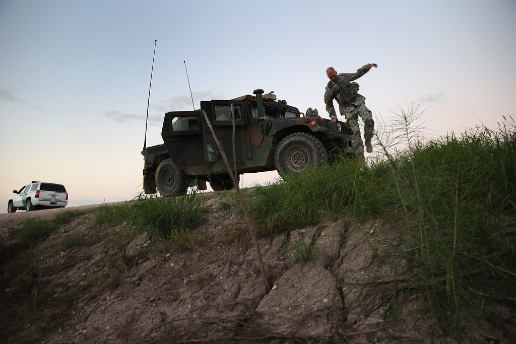 . Texas National Guard troops watch for illegal immigrant crossings near the Rio Grande River at the U.S.-Mexico border on September 8, 2014 near McAllen, Texas.  (Photo by John Moore/Getty Images)