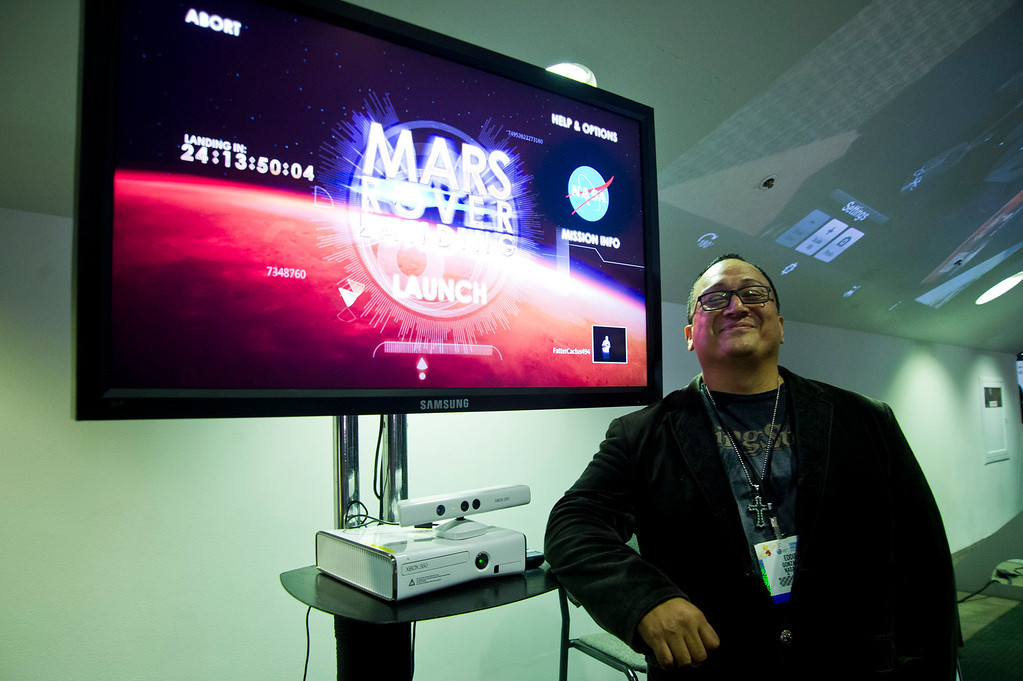 . Eddie Gonzales of JPL explains the Mars Landing Rover game create by NASA during the E3 Expo at the Los Angeles Convention Center on Tuesday, June 11, 2013. E3 is the world\'s largest video game industry show. (Staff photo by Watchara Phomicinda/ Los Angeles Media News Group)