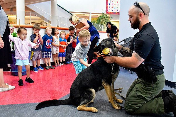 7/25/2019 Mike Orazzi | Staff Xander Albitz meets Bristol Police Officer Conor Hogan with Bronn Dog Days of Summer program held at the Imagine Nation, A Museum Early Learning Center in Bristol Thursday morning.