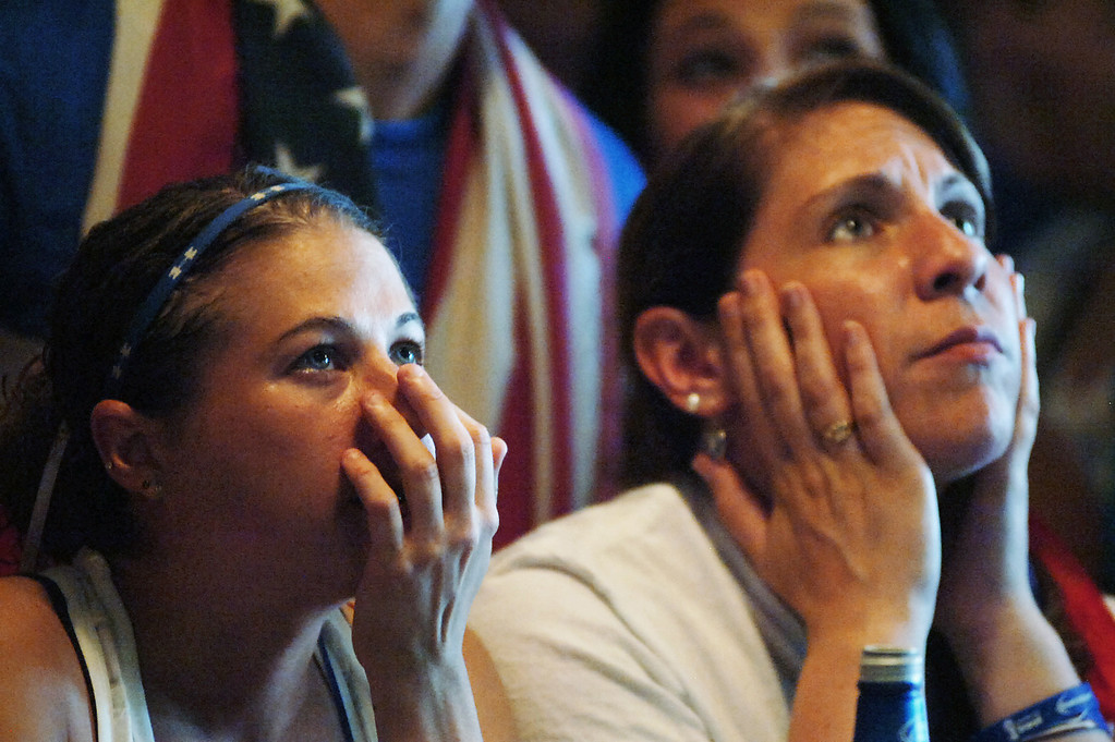 . U.S. soccer fans Melissa Raniella of Dunmore, Pa., left, and Ruth Flanagan of Scranton, Pa., react during the United States 2-1 loss to Belgium during the World Cup soccer match on Tuesday, July 1, 2014 at Ale Mary\'s at The Bittenbender in downtown Scranton, Pa.  (AP Photo/The Scranton Times-Tribune, Butch Comegys)