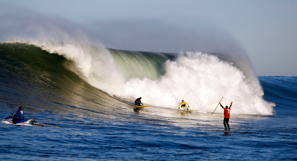 . A paddle boarder wearing a Colin Kaepernick 49ers jersey gets a close up view of contestants practicing for the   Mavericks Invitational surf contest moments before the start of Round One on Sunday, Jan. 20, 2013 at Princeton by the Sea, Calif. (Karl Mondon/Staff)
