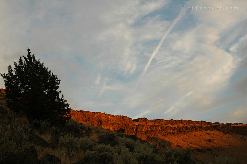 The clouds help add to the dynamic feel of the blood red cliffs.