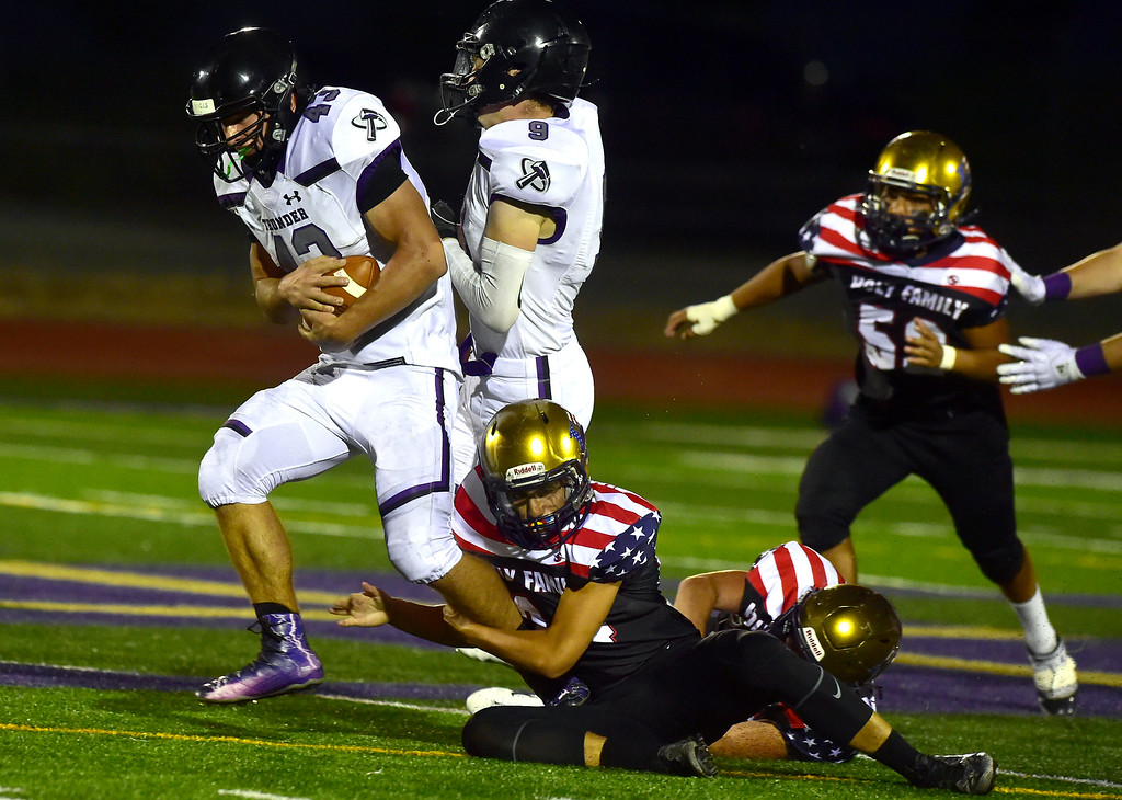 . BROOMFIELD CO - SEPTEMBER 14 2018 Holy Family High School\'s Joseph Hepps wraps up Discovery Canyon High\'s Marshall Pike during their game in Broomfield on Friday September 14, 2018. More photos bocopreps.com  (Photo by Paul Aiken/Staff Photographer)