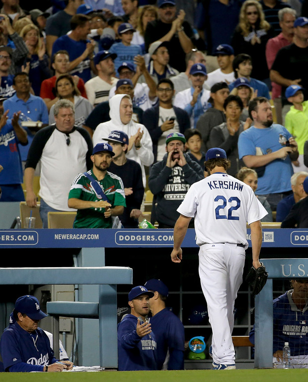 . Los Angeles Dodgers starting pitcher Clayton Kershaw walks to the dugout after the end of the top of the seventh inning of a baseball game against the Colorado Rockies in Los Angeles, Wednesday, June 18, 2014. (AP Photo/Chris Carlson)