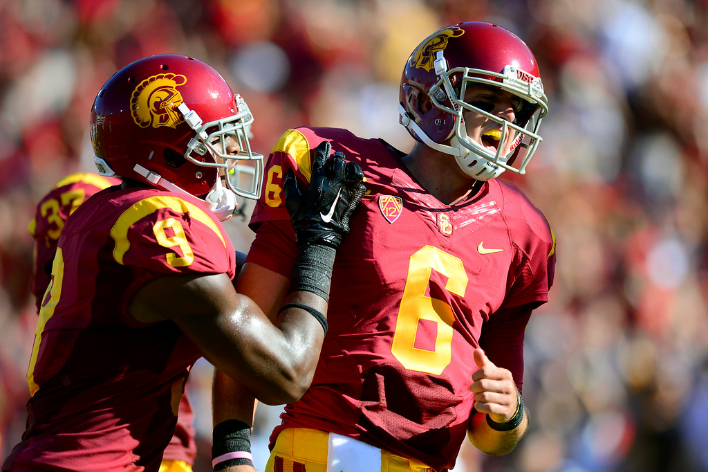 . USC QB Cody Kessler, right, is congratulated by JuJu Smith after his first-quarter touchdown run against Fresno State, Saturday, August 30, 2014, at the L.A. Memorial Coliseum. (Photo by Michael Owen Baker/Los Angeles Daily News)