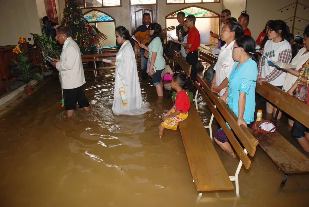 . Christians attend the mass service at a flooded church in Bandung, in western Java island, on December 25, 2014. Millions of Christians in Indonesia celebrate the Christmas eve in the most populous Muslim country. TIMUR MATAHARI/AFP/Getty Images