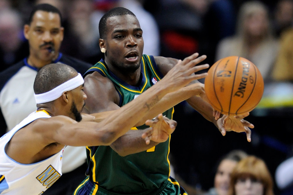 . Utah Jazz forward Paul Millsap, right, and Denver Nuggets forward Corey Brewer reach for a loose ball during the second quarter of an NBA basketball game on Saturday, Jan. 5, 2013, in Denver. (AP Photo/Jack Dempsey)