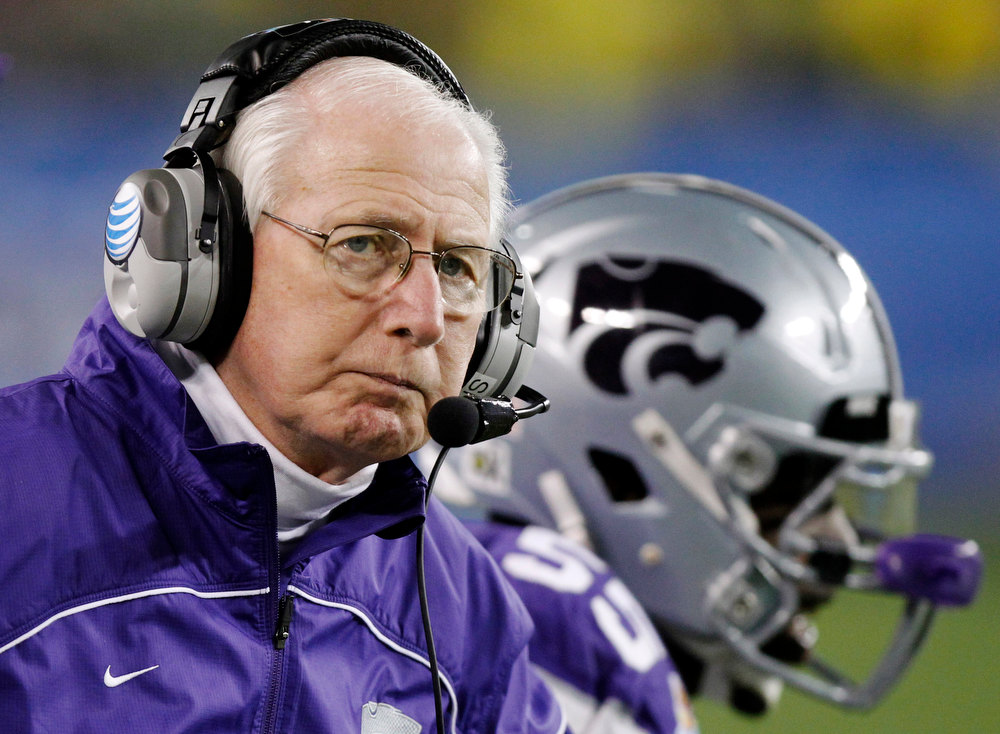 Description of . Kansas State head coach Bill Snyder looks away during the second half of the Fiesta Bowl NCAA college football game against Oregon, Thursday, Jan. 3, 2013, in Glendale, Ariz. (AP Photo/Paul Connors)