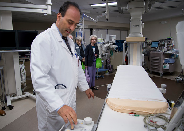 09/18/19 Wesley Bunnell | StaffrrThe Hospital of Central Connecticut held a community forum open to the public on Wednesday night. Andre Ghantous M.D. demonstrates equipment in the cardiac cath lab to visitors.