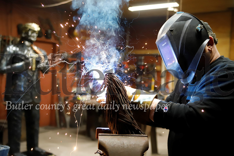 Bill Secunda of Butler demonstrates his metal welding sculpture technique in his workshop at his home in east Butler. Seb Foltz/Butler Eagle