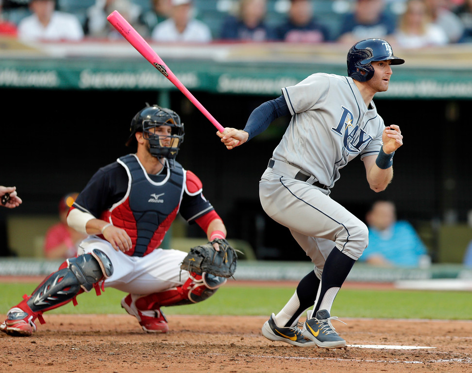 . Tampa Bay Rays\' Brad Miller, right, hits an RBI-single off Cleveland Indians starting pitcher Carlos Carrasco in the fourth inning of a baseball game, Monday, May 15, 2017, in Cleveland. Kevin Kiermaier scored on the play. Indians catcher Yan Gomes, left, watches. (AP Photo/Tony Dejak)