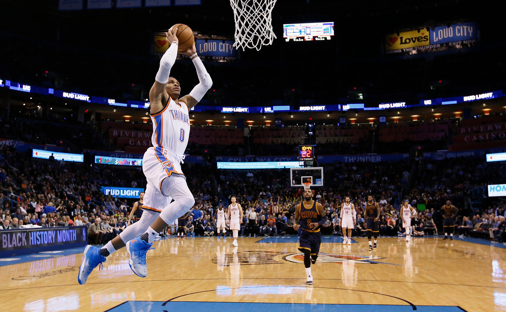 . Oklahoma City Thunder guard Russell Westbrook (0) goes up for an unopposed dunk during the third quarter of the team\'s NBA basketball game against the Cleveland Cavaliers in Oklahoma City, Thursday, Feb. 9, 2017. Oklahoma City won 118-109. (AP Photo/Sue Ogrocki)