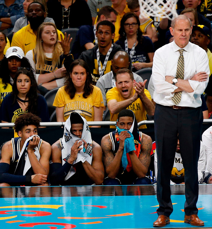 . Players on the Michigan bench watch during the second half in the championship game of the Final Four NCAA college basketball tournament against Villanova, Monday, April 2, 2018, in San Antonio. (AP Photo/Brynn Anderson)