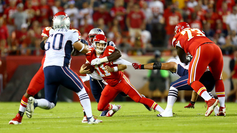 . Alex Smith #11 of the Kansas City Chiefs is sacked by Chandler Jones #95 of the New England Patriots  during the first quarter at Arrowhead Stadium on September 29, 2014 in Kansas City, Missouri.  (Photo by Dilip Vishwanat/Getty Images)