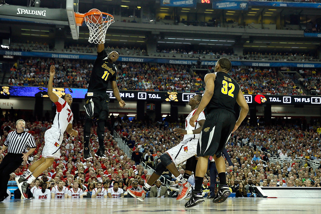 . ATLANTA, GA - APRIL 06:  Cleanthony Early #11 of the Wichita State Shockers dunks in the first half against the Wayne Blackshear #20 of the Louisville Cardinals during the 2013 NCAA Men\'s Final Four Semifinal at the Georgia Dome on April 6, 2013 in Atlanta, Georgia.  (Photo by Kevin C. Cox REMOTES/Getty Images)