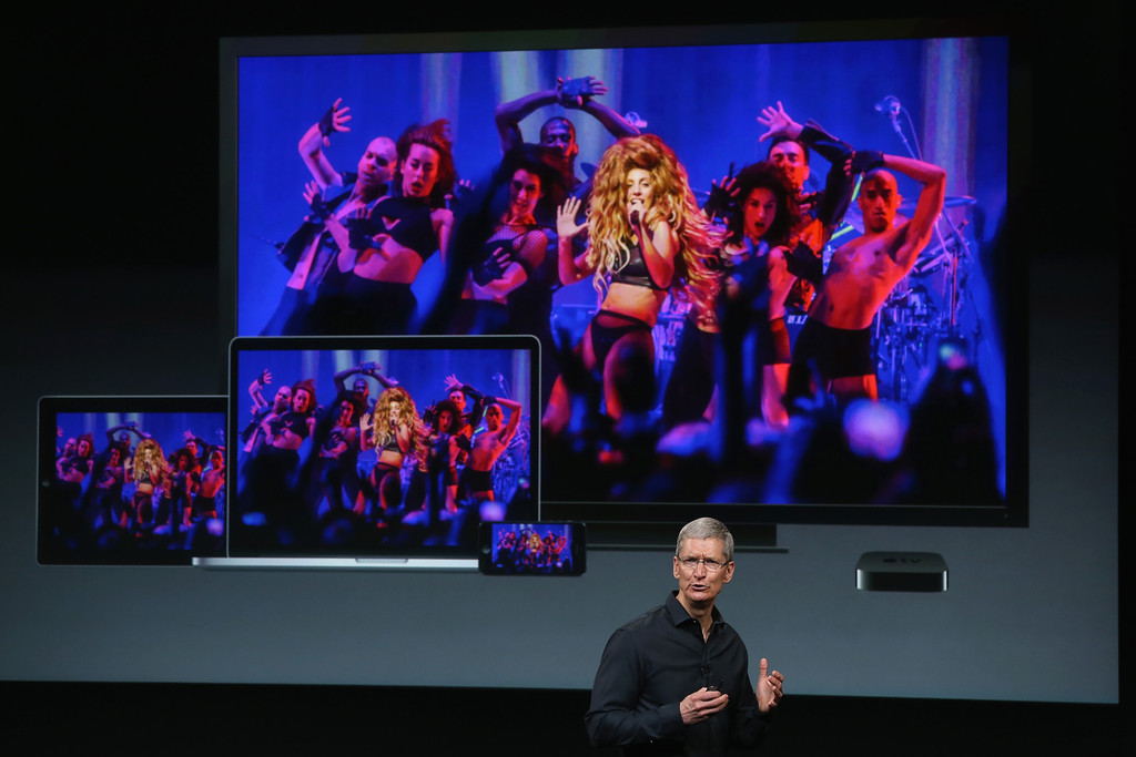. Apple CEO Tim Cook speaks about the iTunes music festival on stage during an Apple product announcement at the Apple campus on September 10, 2013 in Cupertino, California.   (Photo by Justin Sullivan/Getty Images)