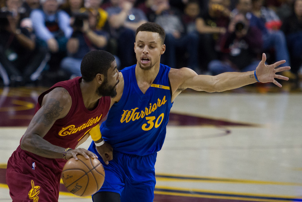 . Kyrie Irving (2) of the Cleveland Cavaliers drives past Stephen Curry (30) of the Golden State Warriors during an NBA game at the Quicken Loans Arena on Christmas day.  The Cavs defeated the Warriors 109-108.  Michael Johnson - The News Herald