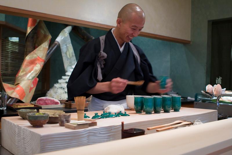 Course #1: Cold Citrus Soup  This soup contained citrus juice, shrimp, scallion garnish.  Here is Hiro preparing the course