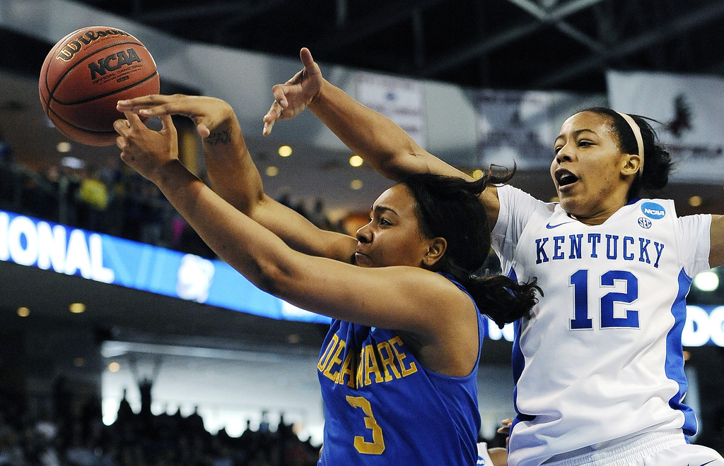. Delaware guard Jaquetta May (3) tries to grab a rebound against Kentucky\'s Jelleah Sidney (12) during the first half of a regional semifinal in the women\'s NCAA college basketball tournament in Bridgeport, Conn., Saturday, March 30, 2013. (AP Photo/Jessica Hill)