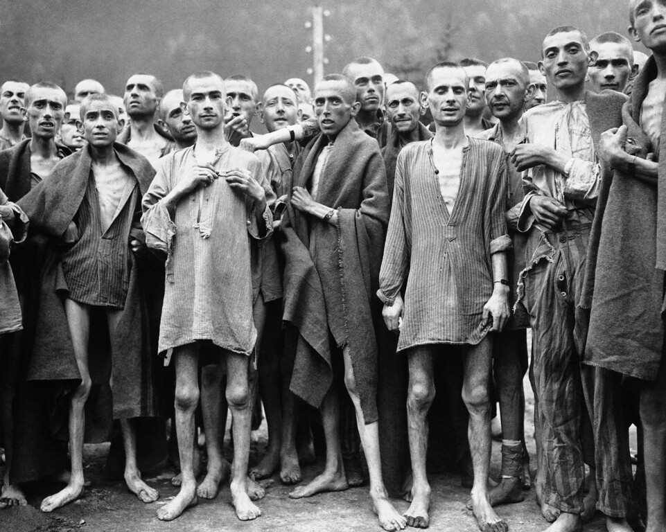 """. Starved prisonerís, nearly dead from hunger, at one of the largest Nazi Concentration camps at Evensee Austria, in the Austrian Alps, May 7, 1945. Many were starving to death and inmates were dying at the rate of 2,000 per week. The camp was reputedly used for \""""Scientific\"""" experiments. It was liberated by the 80th Division, U.S. Third Army. (AP Photo)"""