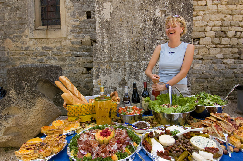 Trek Travel guide Courtney Mae Webber prepares a gourmet picnic lunch infused with regional Provencal fare while guests explore the château of Marquis de Sade in the hilltop town of Lacoste.