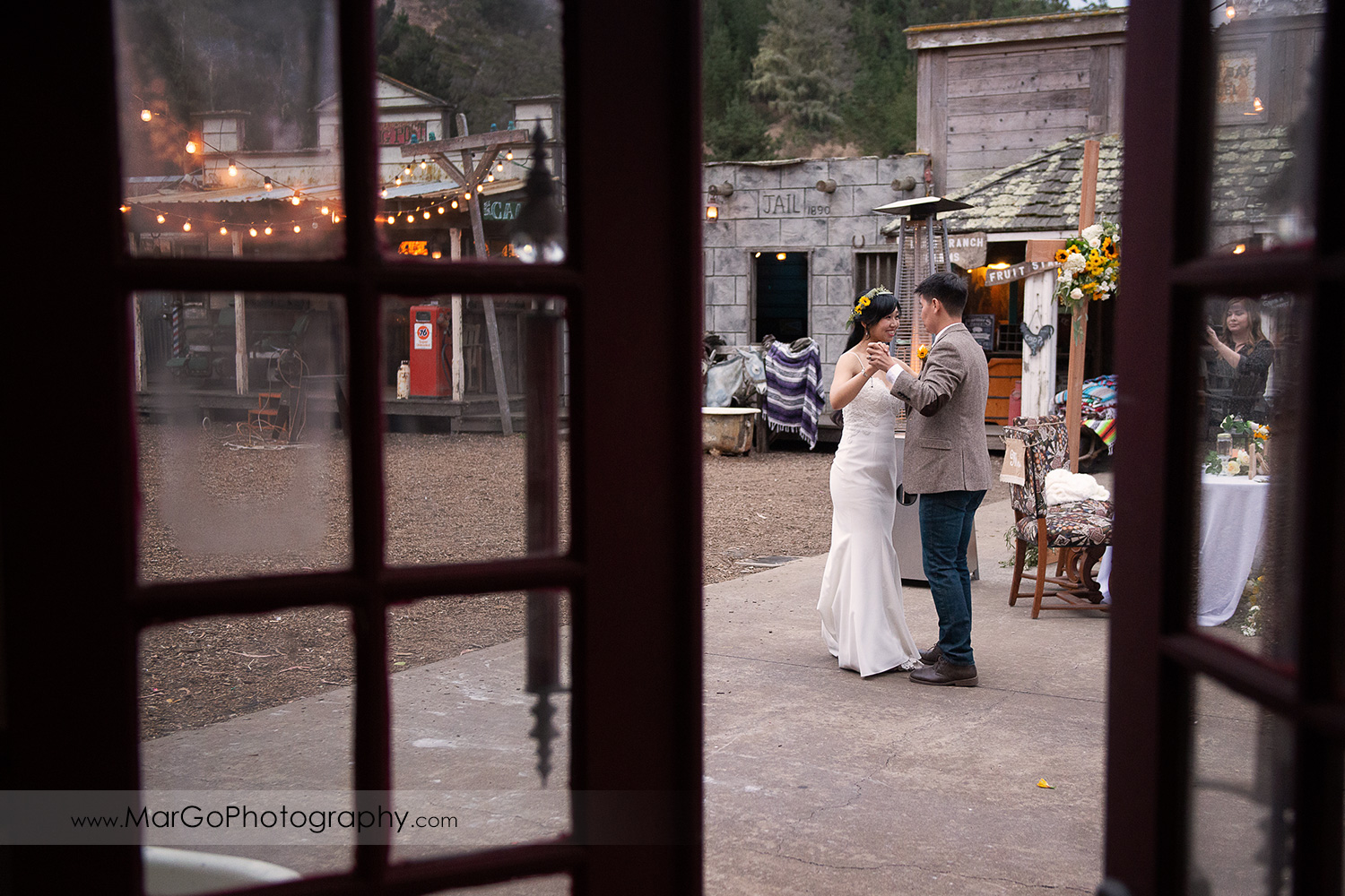 door shot of first dance of bride and groom during wedding reception at Long Branch Saloon & Farms in Half Moon Bay