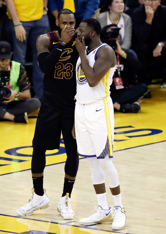 . Cleveland Cavaliers forward LeBron James, left, talks with Golden State Warriors forward Draymond Green during the second half of Game 1 of basketball\'s NBA Finals in Oakland, Calif., Thursday, May 31, 2018. (AP Photo/Marcio Jose Sanchez)