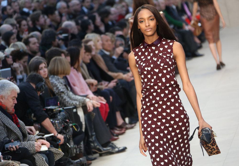 Description of . British model Jourdan Dunn wears a design created by Burberry Prorsum during London Fashion Week, at Kensington Gardens in west London, Monday, Feb. 18, 2013. (Photo by Joel Ryan/Invision/AP)