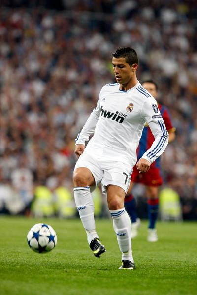 Cristiano ronaldo controlling the ball, UEFA Champions League Semifinals game between Real Madrid and FC Barcelona, Bernabeu Stadiumn, Madrid, Spain