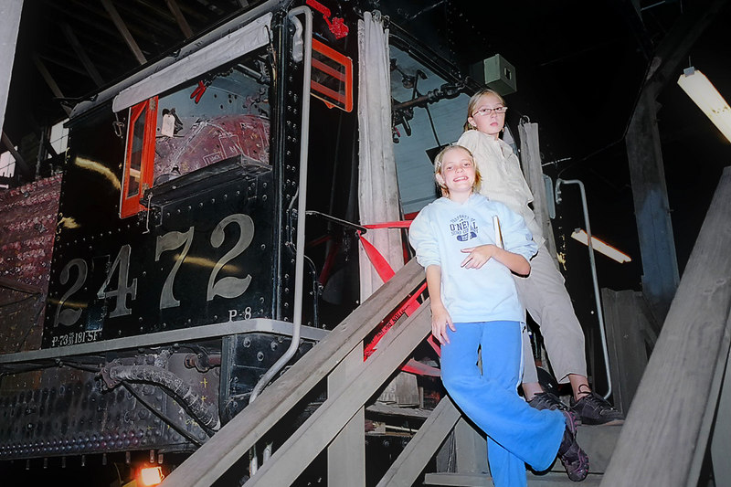 The girls by an historic steam engine.
