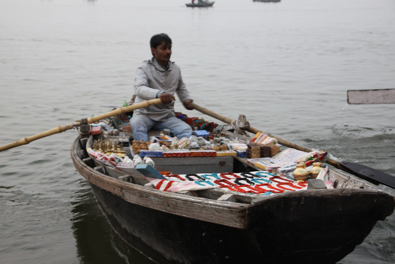 selling offerings to the Gods by boat