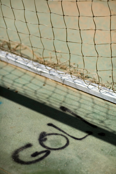 """The Spanish word """"gol!"""" (goal!) painted on the ground by a football goal, Seville, Spain"""