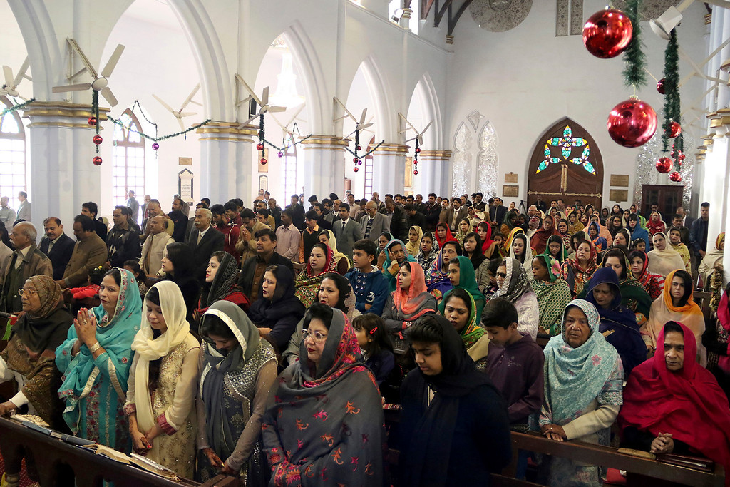 . Pakistani Christians woman attend the Christmas mass at a church in Peshawar, Pakistan, Sunday, Dec. 25, 2016. (AP Photo/Mohammad Sajjad)
