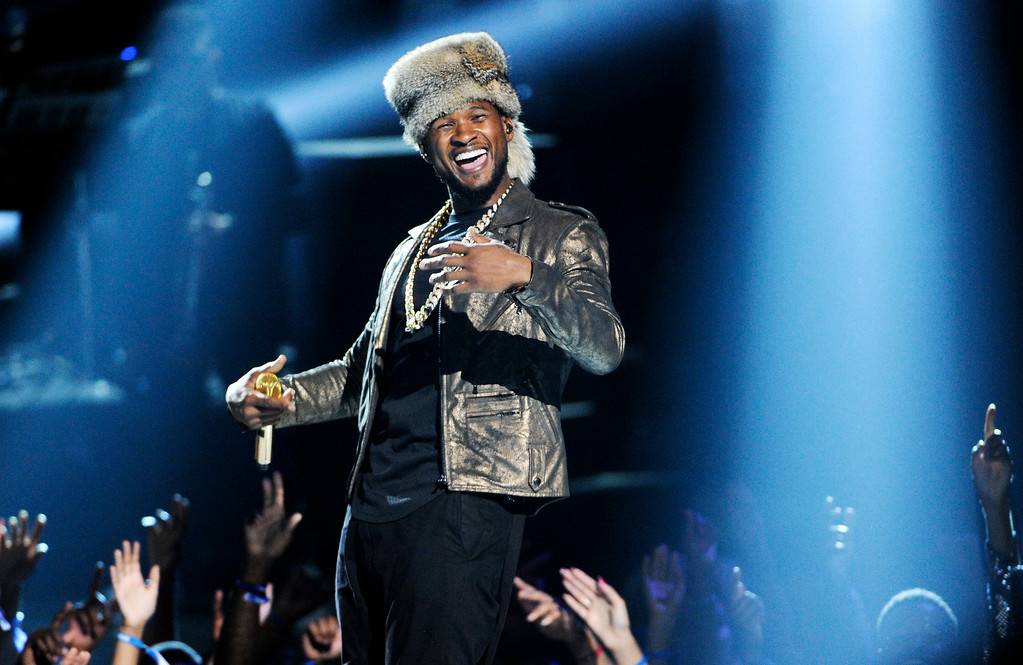. Usher performs at the BET Awards at the Nokia Theatre on Sunday, June 29, 2014, in Los Angeles. (Photo by Chris Pizzello/Invision/AP)