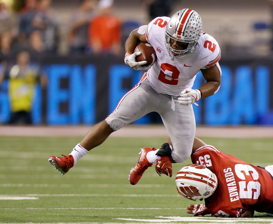 . Ohio State running back J.K. Dobbins (2) eludes Wisconsin linebacker T.J. Edwards during the first half of the Big Ten championship NCAA college football game, Saturday, Dec. 2, 2017, in Indianapolis. (AP Photo/Michael Conroy)