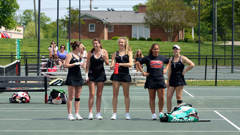Teammates cheer on players during Sunday's 7-0 win over Western Carolina