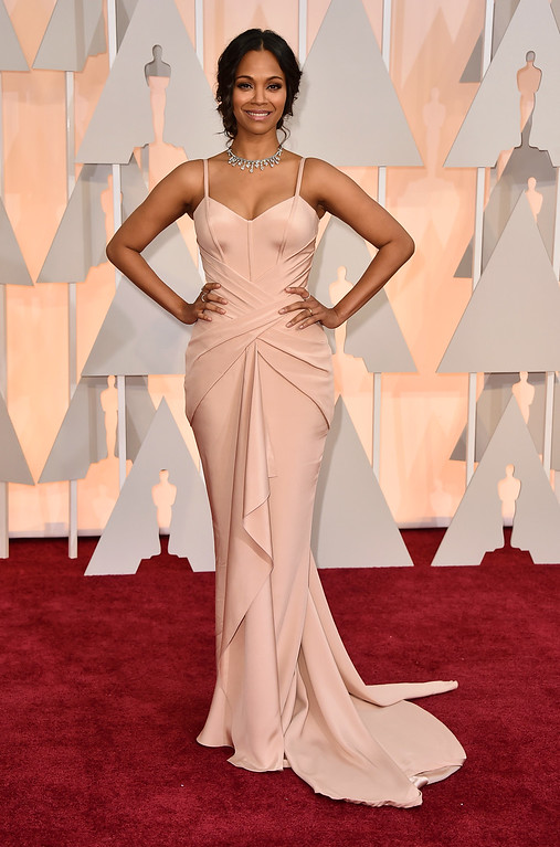 . Zoe Saldana arrives at the Oscars on Sunday, Feb. 22, 2015, at the Dolby Theatre in Los Angeles. (Photo by Jordan Strauss/Invision/AP)