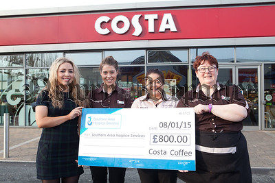 Leanne Redmond (Pictured left) from southern Area hospice accepts a cheque for £800 from staff at Costa Coffee Damolly Retail Park money raised during a Christmas Event. R1503004