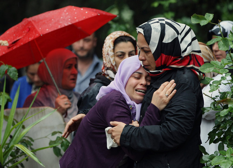 . Mourning relatives cry during the burial of one of the 46 victims killed in Saturday explosions in Reyhanli, near Turkey\'s border with Syria, Sunday, May 12, 2013. The bombings on Saturday marked the biggest incident of cross-border violence since the start of Syria\'s bloody civil war and has the raised fear of Turkey being pulled deeper into the conflict.   (AP Photo/Burhan Ozbilici)