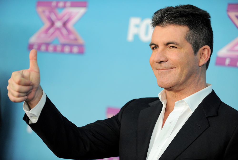 ". Simon Cowell attends the ""The X Factor\"" season finale results show at CBS Television City on Thursday, Dec. 20, 2012, in Los Angeles. (Photo by Jordan Strauss/Invision/AP)"