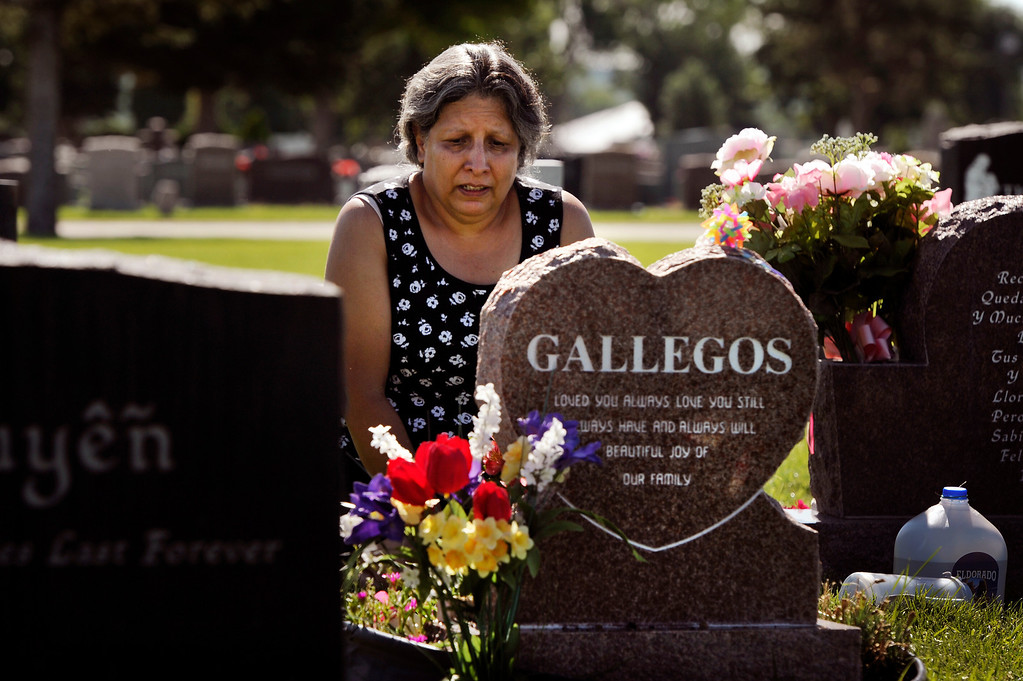 """. Janet Gallegos visits the grave of her granddaughter, Neveah Gallegos,  at Mount Olivet Cemetery in Wheat Ridge, CO, Wednesday, August 01, 2012. It would be Neveah\'s eighth birthday.  Janet  said, \""""I\'m trying, spiritually, to let go of her� in peace. I miss her� she would be 8 years old today. I\'m sad I can\'t be with her anymore. Such a young age and so tragic. I\'m trying to come to terms but I hold her in my heart. She was never sad.\"""" On Sept. 24, 2007, Miriam Gallegos returned to her Denver apartment after work and found her 3-year-old daughter dead. Instead of calling police, she helped her boyfriend, Angel Ray Montoya, stuff the girl�s body into a garbage bag. As Montoya went to dump Neveah�s body, Gallegos left and told police that Neveahhad been kidnapped, according to court records. An autopsy report included three pages of traumatic injuries found on Neveah�s 30-pound body. The coroner could not determine which of them led to her death. Montoya, 26, was convicted of first-degree murder and sentenced to life in prison without parole. Miriam Gallegos, 24, pleaded guilty to child abuse resulting in death and sentenced to 12 years in prison. Craig F. Walker, The Denver Post"""