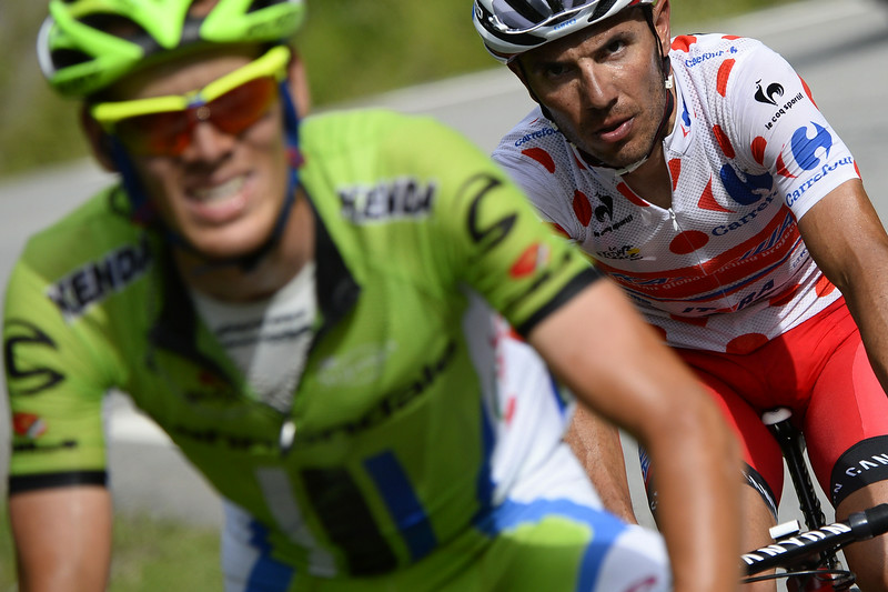 . Spain\'s Joaquim Rodriguez (R) wearing the best climber\'s polka dot jersey rides in a breakaway behind Italy\'s Alessandro De Marchi during the 177 km fourteenth stage of the 101st edition of the Tour de France cycling race on July 19, 2014 between Grenoble and Risoul, eastern France. (LIONEL BONAVENTURE/AFP/Getty Images)
